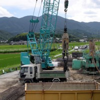 7070 and Hammer Grab working on the bridge foundation (Fukuoka, Japan)